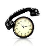 Telephone and clock Stock Photos