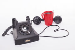 Telephone and coffee Stock Photography