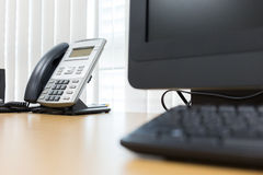 Telephone and computer on table work of room service Royalty Free Stock Image