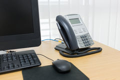 Telephone and computer on table work Royalty Free Stock Photos