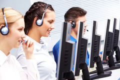 Telephone conversation. Group of customer representatives working in the computer class Stock Image