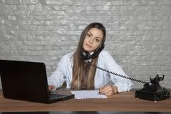 Telephone conversation and signing documents at the same time. Portrait of a business person stock image