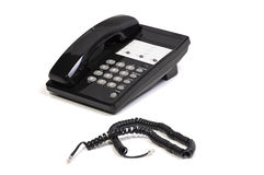 Telephone and Cord. Black Office Telephone and Phone Cord on White Background stock photography