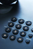 Telephone dialer. Black telephone dialer macro shot stock image