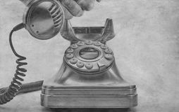 Telephone dialing with paper filter applied to photo Royalty Free Stock Image