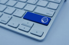 Telephone and email icon on modern computer keyboard button, Con Royalty Free Stock Photos