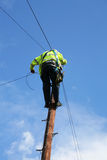 Telephone Engineer. Technician working up telegraph pole Royalty Free Stock Images