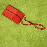 Telephone on floor. Stock Images