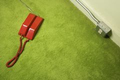 Telephone on floor. Royalty Free Stock Photo