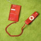Telephone on floor. Royalty Free Stock Image