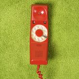 Telephone on floor. Royalty Free Stock Photography