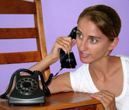 Telephone Girl. Beautiful, green-eyed woman on the telephone Stock Images