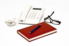 Telephone, glasses, agenda, pen isolated on white Royalty Free Stock Image