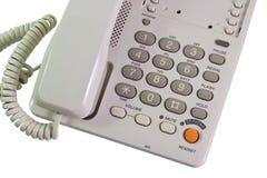 Telephone. Grey shiny telephone on isolate white background royalty free stock photos