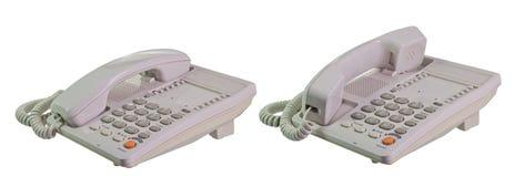 Telephone. Grey shiny telephone on isolate white background stock images