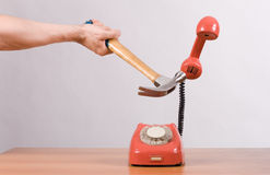 Telephone and a hammer Royalty Free Stock Photo