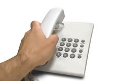 Telephone with hand. The hand takes a telephone Stock Photos