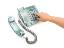 Telephone and hand Stock Image