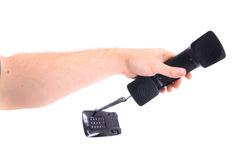 Telephone in the hand. Isolated on the white background Royalty Free Stock Images