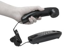 Telephone with hands dialing Royalty Free Stock Photography
