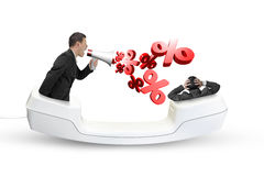 Telephone handset with businessman yelling at another man Stock Photo