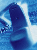 Telephone handset on financial page Royalty Free Stock Image