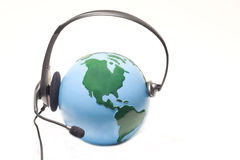 A telephone headset on world globe Stock Photo