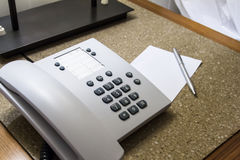 Telephone in Hotel Room with Note Paper Stock Photography