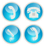 Telephone icons. Blue telephone icons and buttons isolated on white royalty free illustration