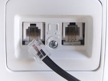 Telephone jack on the house wall. Telephone jack on the house white  wall Stock Image