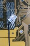 Telephone jack. A phone plug shot against computer circuitry Stock Photos