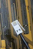 Telephone jack. A phone plug shot against computer circuitry Stock Photography