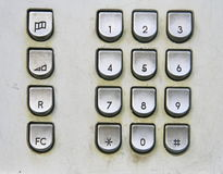 Telephone keyboard in public phone stock images