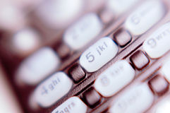 Telephone keypad. Close-up of a telephone keypad with blurry, selective focus effect Royalty Free Stock Photography