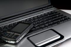 Telephone on laptop Stock Photography