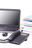 Telephone with laptop and books background. royalty free stock photography