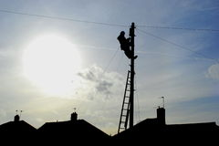 Telephone line. Person repairing telephone line on the post Stock Photo