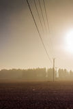 Telephone Lines In The Autumn Sun. The sunrises are quite spectacular in the autumn at the Northern Finland stock photography