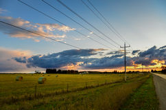 Telephone lines in the country leading into the sunset Stock Image