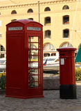 Telephone and mail box. Red telephone and mail box in London Royalty Free Stock Photography