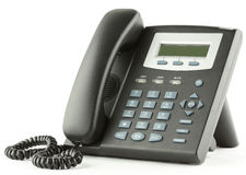 Telephone. Modern plastic black telephone with blue keys Stock Photography