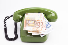 Telephone and money Stock Image