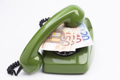 Telephone and money Stock Photography