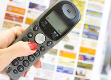 Telephone and newspaper Stock Image