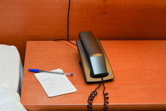 Telephone with note on desk Stock Photos