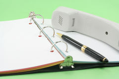 Telephone and notebook Royalty Free Stock Images