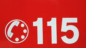 Telephone number 115 on red background of the fire brigade in It Stock Photo