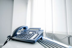 Telephone in an office window Royalty Free Stock Image