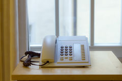 Telephone in an office window Stock Photo
