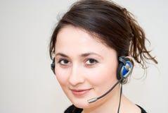 Telephone operator. A friendly / secretary / telephone operator with headphone Royalty Free Stock Images